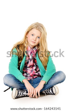 Cute ten years girl wearing casual clothes. Isolated over white.