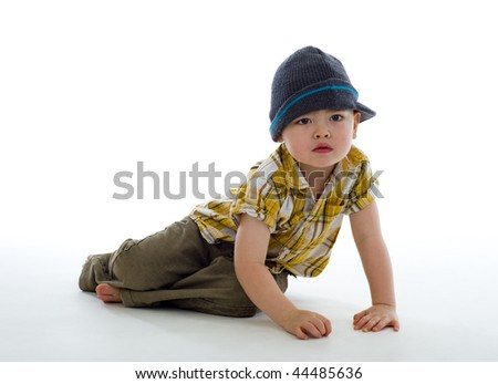 cute thai-english boy on the floor, isolated on white