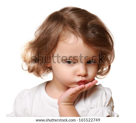 Cute thinking kid girl with hand under face isolated on white - stock photo