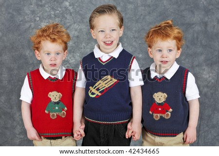 Cute three brothers Christmas portrait - stock photo