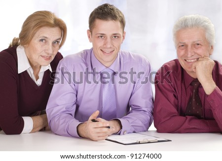 cute three business people sitting at table - stock photo