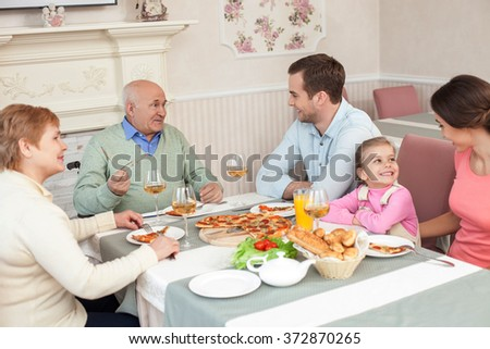 Cute three generations are gathering together in restaurant - stock photo