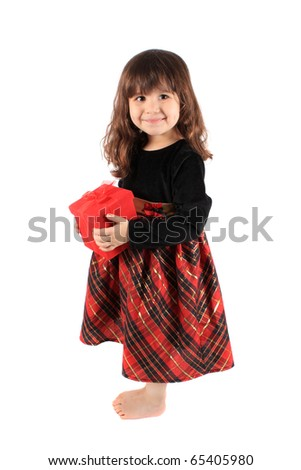 Cute three year old little girl dressed up in a fancy dress  holding a red giftbox standing barefoot on a white background - stock photo