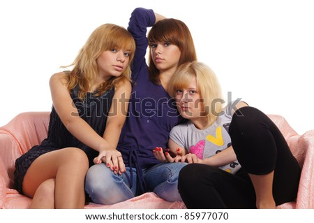 cute three young girls posing on white