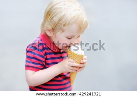 Cute toddler boy eating Ice-Cream  - stock photo