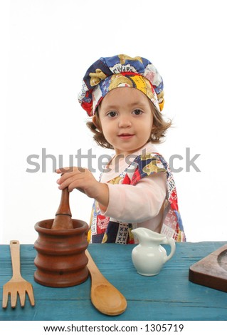 Cute toddler cooking dressed as a chef. More pictures of this baby at my gallery - stock photo