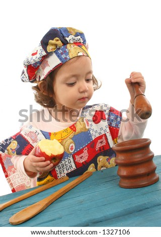 Cute toddler cooking dressed as a chef. More pictures of this baby at my gallery