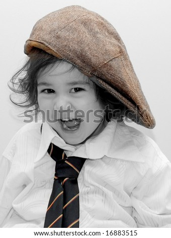 cute toddler girl dressed up like her dad - stock photo