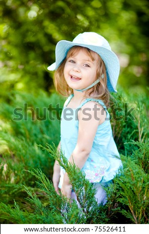 cute toddler girl in the garden - stock photo