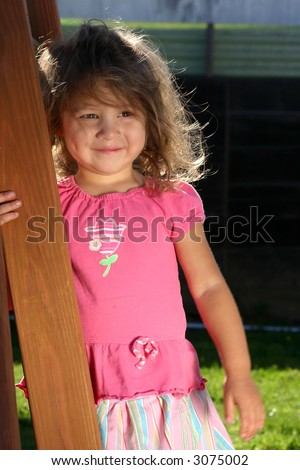 Cute toddler girl outside in the evening light
