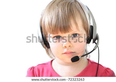 Cute toddler girl with a headset over white background