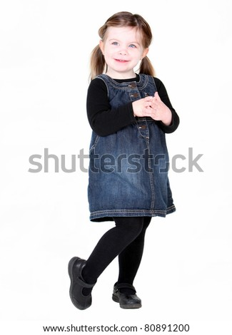 Cute toddler girl with hands folded on white background