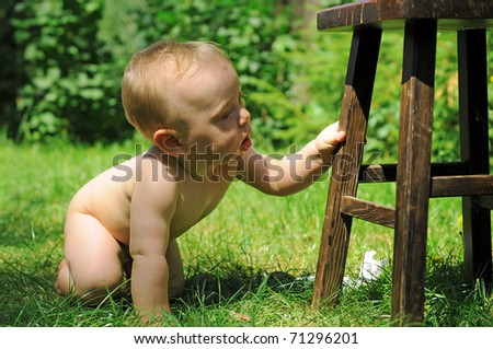 Cute toddler playing outdoor in the grass