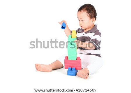 Cute toddler playing with block toys, isolated on white background - stock photo