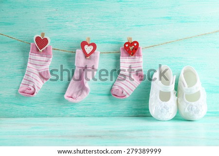 Cute toddler shoes on wooden background - stock photo