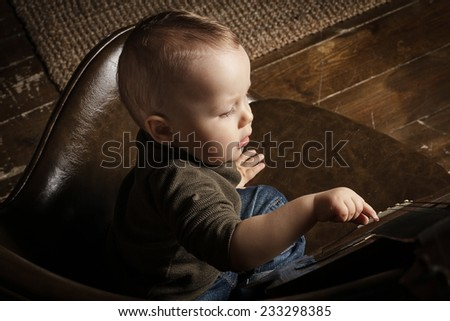 Cute toddler with guitar - stock photo