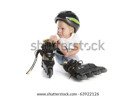 cute toddler with roller skates over white - stock photo