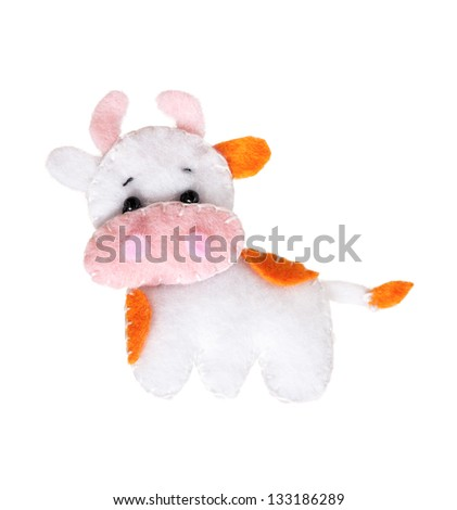 Cute toy cow - handmade, isolated on white background - stock photo