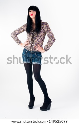 Cute transvestite man dressed as woman at white background. - stock photo