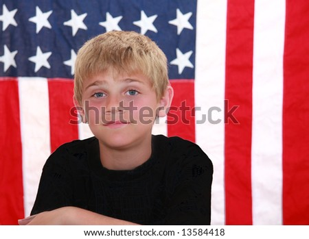 Cute tween boy in front of the USA flag.