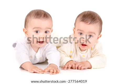 cute twin babies isolated in white background - stock photo