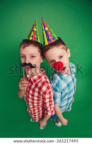 Cute twin brothers celebrating foolâ??s day
