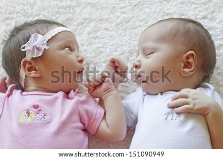 Cute twins sleeping together, a boy and a girl - stock photo