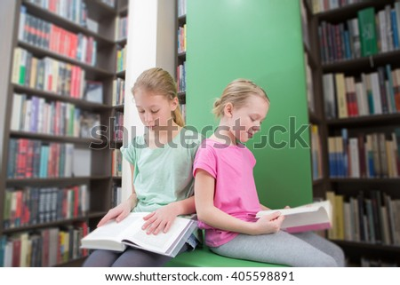 Cute  two girls reading book in library