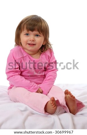 Cute two year old girl with a mischievous grin - stock photo