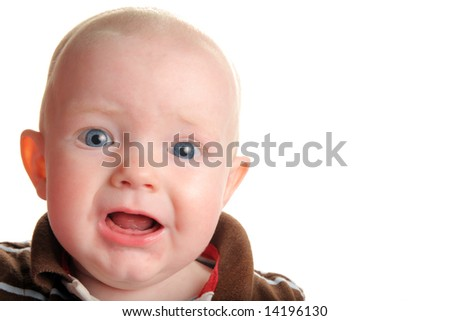 Cute unhappy or surprised baby isolated on white - stock photo