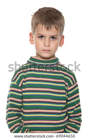 Cute upset boy isolated on a white background - stock photo