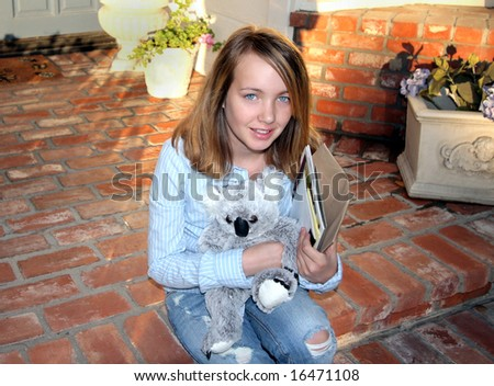 Cute Waiting Young Girl On Steps - stock photo