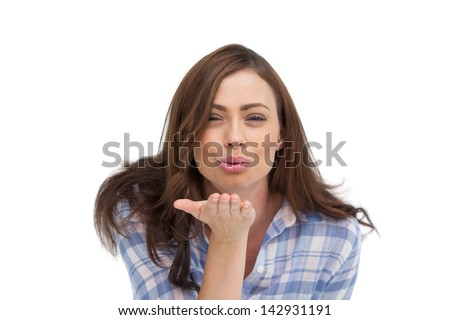 Cute woman blowing a kiss to the camera on white background - stock photo