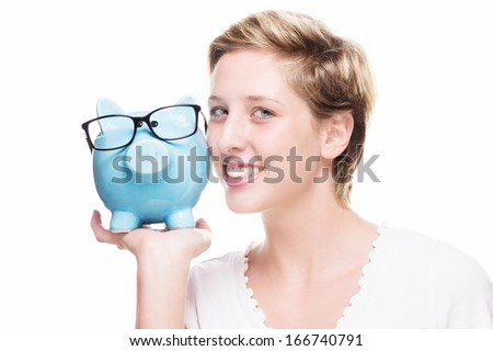 cute woman cuddling with a piggy bank on white background - stock photo