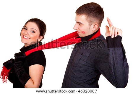cute woman dragging his boyfriend with her scarf