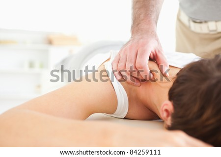 Cute Woman getting a neck-massage in a room - stock photo