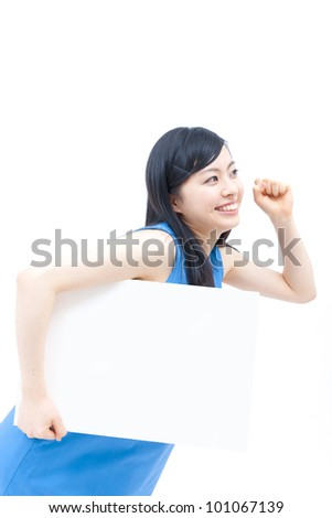 Cute woman holding blank white board. - stock photo