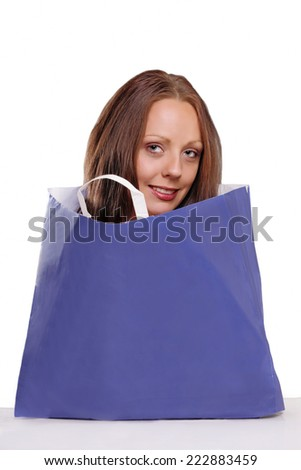 Cute woman in paper bag, with copy space - stock photo