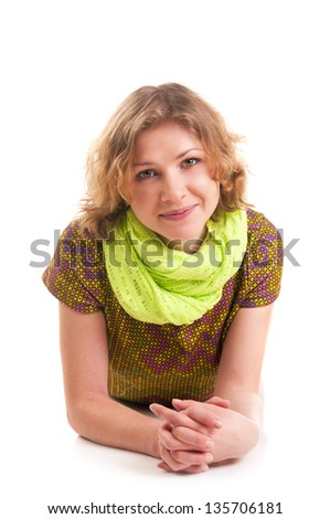 Cute woman lying on the floor isolated on a white background - stock photo