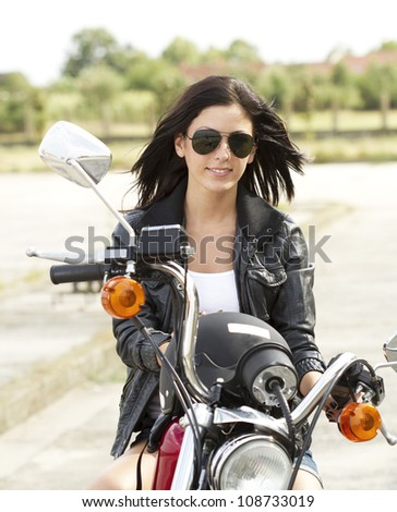 Cute Woman on a motorcycle