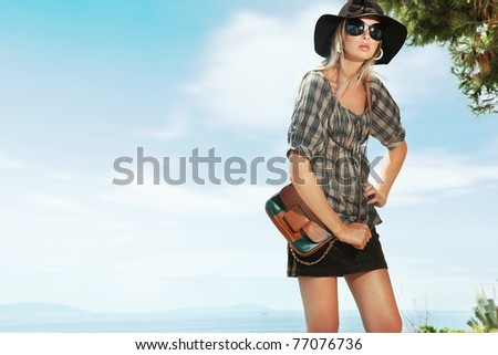Cute woman over blue sky background - stock photo