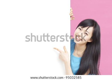 Cute woman pointing blank white board. - stock photo