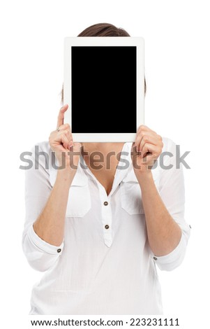 Cute woman presenting a digital tablet in front of her face, isolated on white - stock photo