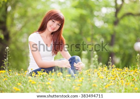 Cute woman rest in the park with flowers - stock photo