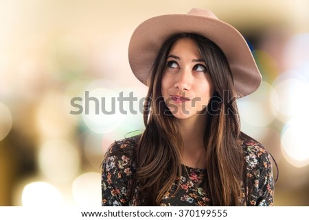 Cute woman thinking - stock photo