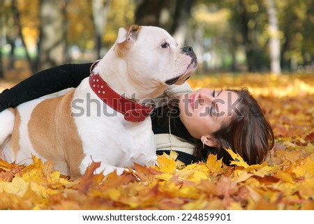 cute woman walking with dogs - stock photo