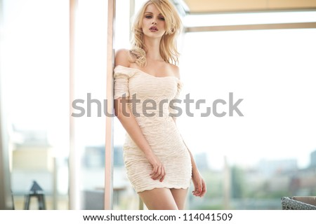 Cute woman wearing white dress - stock photo