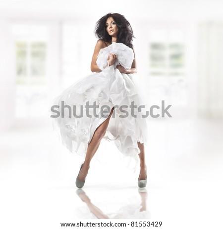 Cute woman wearing white dress - stock photo