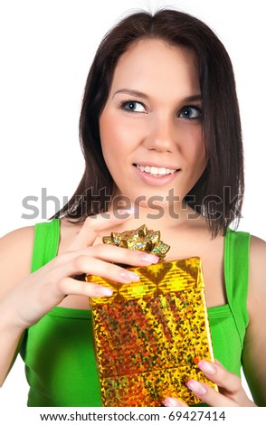 Cute woman with a gift. Studio isolated
