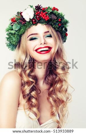 Cute Woman with Blond Permed Hair, Red Lips Makeup and Green Christmas Wreath